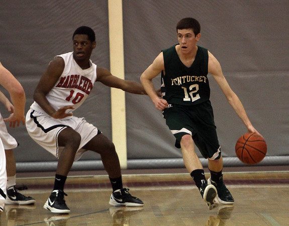 Pentucket's Corey McNamara (12) right, looks to pass while being defended by a Marblehead player. David Le/Staff Photo