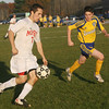 Masco's Charlie Behrens (7) left, carries the ball upfield against Acton-Boxborough's Andrew Curran on Wednesday afternoon. David Le/Salem News