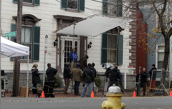 "The crew for a horror movie called ""Lords of Salem,"" written and directed by Rob Zombie, worked through the rain to shoot on the corner of Essex and Hamilton Streets on Thursday afternoon. David Le/Salem News"