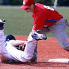 Burlington High School shortstop Jimmy Goober tags out Danvers runner Anthony Garron as he tries to steal second base on Wednesday. David Le/Staff Photo