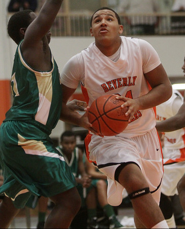 Beverly: Beverly's Ty Suggs (24) right, goes up strong against Lynn Classical on Tuesday night. David Le/Salem News
