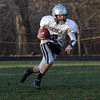 Hamilton-Wenham quarterback Trevor Lyons runs the ball during practice on Thursday. David Le/Salem News