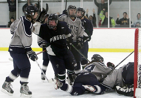 Pingree's Jillian Witwicki, center, celebrates after scoring the game winning goal in overtime against Newton Country Day School on Wednesday afternoon. David Le/Staff Photo