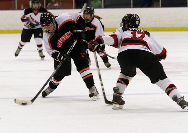 Beverly's Caitlin McBride, left, fires a shot on net around Marblehead's Brittany Smith (17). David Le/Salem News
