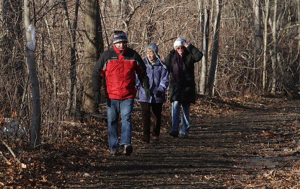 A group of walkers from the Danvers Bi-Peds Chocolate Stroll return from their walk through the northern part of The Danvers Rail Trail on Saturday afternoon. David Le/Salem News