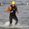 Vance Garry, of Ipswich, splashes out of the water at Crane's Beach during the Ipswich YMCA Triathalon on Friday evening.David Le/Staff Photo