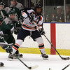 Salem State defenseman Dan Smolinsky (28) carries the puck between two Plymouth State defenders. David Le/Salem News