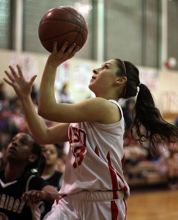 Masco senior guard Taylor Evans goes in for a layup on Senior Night against Camridge. David Le/Salem News