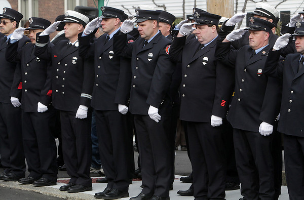 Peabody: Firefighters from across the country saluted deceased firefighter Jim Rice on Friday morning. David Le/Salem News