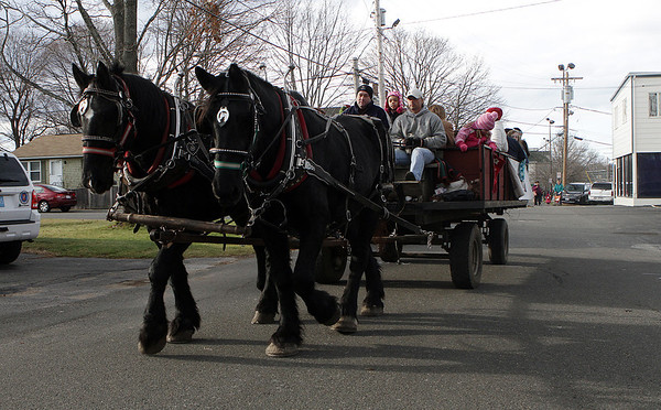 A horse drawn hay ride was one of the many activities at Pope's Landing in Danvers on Saturday afternoon, as Santa Claus arrived by boat and spent the afternoon with local kids. David Le/Salem News