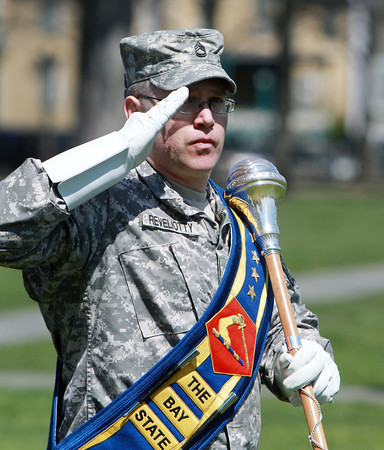 SFC Michael Reveliotty, of the 215th Army Band of the Massachusetts Army National Guard, salutes as he passes keynote speaker and Interim Commander of the Massachusetts National Guard, Major General L. Scott Rice. David Le/Staff Photo