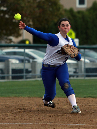 Danvers third baseman Caitlin McBride fires the ball to first base to throw out a Peabody runner on Wednesday afternoon. David Le/Staff Photo