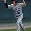Danvers American right fielder Tim Usalis celebrates his 3rd inning grand slam that gave Danvers a 6-4 lead over Manchester-Essex on Thursday evening at Harry Ball Field. David Le/Staff Photo