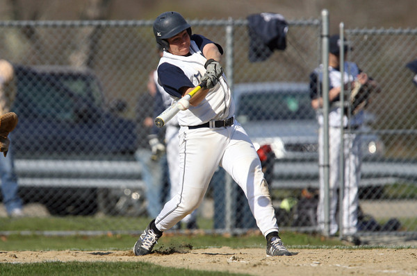 Hamilton-Wenham's Paul Dimarino lines a hit into the gap against North Reading on Tuesday afternoon. David Le/Staff Photo