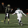Bishop Fenwick quarterback Fan Hannon drops back to pass against Austin Prep on Wednesday night. David Le/Salem News
