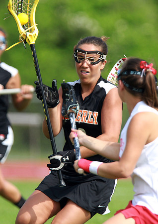 Beverly's Camden Vitale, left, can't find any room to manuever while being defended by Masco's Alison Foden, right, on Tuesday afternoon. The Chieftans defeated the Panthers 11-7 in the first round of the MIAA D1 Tournament. David Le/Staff Photo