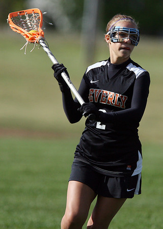 Beverly's Mandy Cecchini looks to pass against Masco on Friday afternoon. David Le/Staff Photo