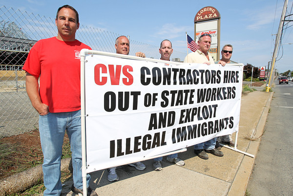 From left, Mike Sara, Tony Antonucci, James Pimental, Riley Kramer, and Nick Driscoll, stand on the sidewalk in front of Loring Plaza to protest the new CVS being built there. David Le/Staff Photo