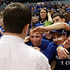 A large crowd of Danvers fans congratulate Head Coach John Walsh on winning the D3 State Basketball Championship in just his second year at the helm. David Le/Staff Photo