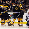 Dennis Seidenberg (44) left, and Nathan Horton (18) center, celebrate David Krejci's third period goal. David Le/Salem News