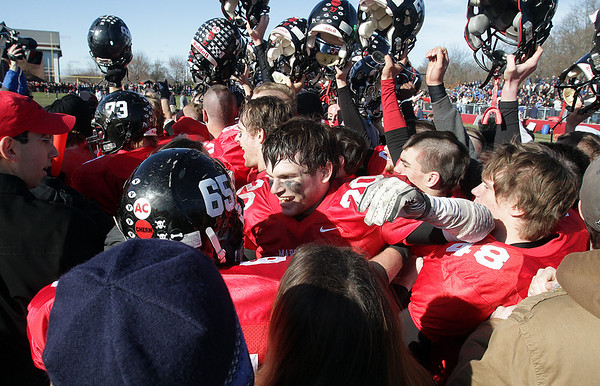 Marblehead star running back Will Quigley (20) and the rest of the Magicians celebrate their 21-7 win over Swampscott on Thursday mornig. David Le/Salem News