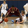 BC High's Charles Collins (14) left, tries to maintain a dribble as St. John's Prep point guard Tyler Dooley, right, attempts to steal the ball. David Le/Salem News