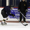 Peabody: Bishop Fenwick's Andrew Young flies up-ice with the puck during practice last week. David Le/Salem News
