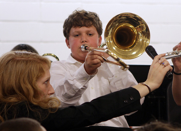 Cole Schildkraut, a 5th grade student at the Paul F. Doyon Memorial School plays a trombone solo during the winter concert on Tuesday afternoon. David Le/Salem News