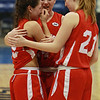 From left, tearful Masco seniors Taylor Evans, Julia Simonetti, and Katie Hutchinson, console each other following a loss to Andover in the D1 North Final. David Le/Staff Photo