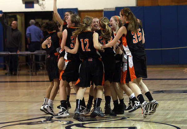 The Ipswich High School girls basketball team celebrates a win over Bedford High School to advance to the D3 North Girls Basketball Final on Saturday at the Tsongas Center in Lowell. David Le/Staff Photo