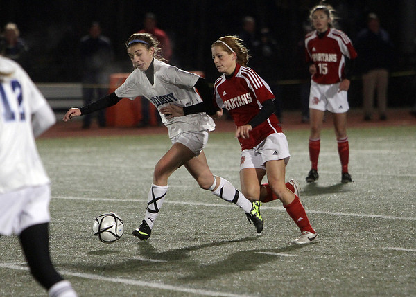 Peabody's Madison Doherty (20) left battles for possession of the ball on Friday night., David Le/Salem News