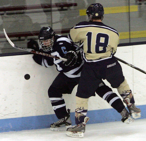 Peabody's Andrew Bucci tries to maintain control of the puck while being checked by Winthrop's Brendan Loomis during last night's Division 1 North Semifinal game held at Chelmsford Forum Arena. Photo by Deborah Parker/March 1, 2010<br /> , Peabody's Andrew Bucci tries to maintain control of the puck while being checked by Winthrop's Brendan Loomis during last night's Division 1 North Semifinal game held at Chelmsford Forum Arena. Photo by Deborah Parker/March 1, 2010