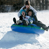 Topsfield: Junior high friends, Samantha Doonan, 13, top, Kellie Roach, 13, and Shey Coughlan, 13, all of Ipswich react to hitting a jump in their inner tube sled while sledding on Wheatland Hill in Topsfield Saturday morning. Photo by Deborah Parker/Salem News Saturday, January 24, 2009.
