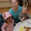 Beverly: Donna Davies of Beverly and her two children, Brooke, 3, and Reid, 1, enjoy some eggs and pancakes while the Italian Community Center Saturday morning. The Kiwanis Club held a breakfast, complete with characters and free books,  to celebrate Dr. Seuss' 105th birthday. Photo by Deborah Parker/Salem News Saturday, March 21, 2009.