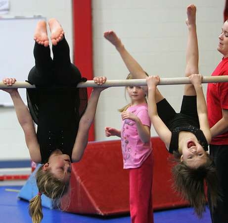 Alexi Woodward, 10, of Essex, left and Lyric Simoglou, 7, of Beverly have some fun during their gymnastic class at the Sterling YMCA in Beverly Wednesday evening. Photo by Deborah Parker/February 10, 2010