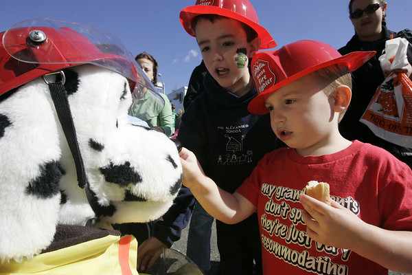 Beverly : From left, Joshua Millen, 5, and Carl Moca, 3, both of Beverly, examine a mechanical fire dog puppet during Beverly Fire Department's open house Saturday.<br /> Photo by Deborah Parker/Salem News Saturday, October 11, 2008