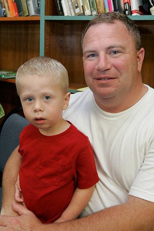 """Gino Spelta of Swampscott and his son, Jacob, 2, enjoy the """"Pirates Night"""" family night program at the Swampscott Library Tuesday. The event included live pirate performers along with a temporary tattoo to wear through the evening. Photo by Deborah Parker/July 7, 2009."""