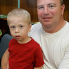 "Gino Spelta of Swampscott and his son, Jacob, 2, enjoy the ""Pirates Night"" family night program at the Swampscott Library Tuesday. The event included live pirate performers along with a temporary tattoo to wear through the evening. Photo by Deborah Parker/July 7, 2009."