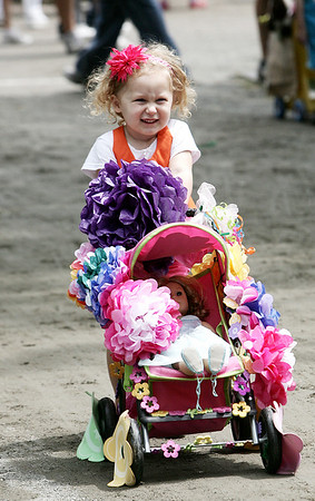 Flynn Plowman, 3, of Georgetown smiles as she shows off her carraige to the judges during Saturday's Doll Carriage Parade at Endicott as part of Endicott Park Day. Photo by Deborah Parker/June 20, 2009