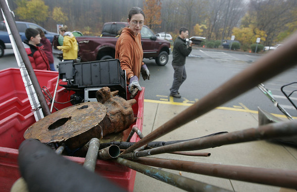 Beverly : Melissa Freedman of Beverly organizes several pieces of scrap metal that were dropped off as part of the scrap metal drive at the North Beverly School Saturday morning. The drive helped to raise funds for the Beverly Boundless Playground project. Everything from refridgerators to old ac units to pieces of random metal were donated. <br /> Photo by Deborah Parker/Salem News Saturday, November 15, 2008