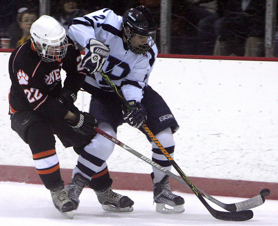 Beverly's Eben Crawford and Peabody's Matt Rodgers fight for control of the puck during Wednesday night game at Mcvann-O'Keefe Rink in Peabody. Photo byDeborah Parker/December 23, 2009