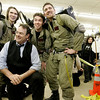 Peabody: Actor Dan Aykroyd poses with some Ghost Busters fans while signing bottles of his new wine at Kappy's Liquors Friday afternoon. From left are brothers, Ed and Matt Bowes of Townsend and their cousin Bill Gauazzie of Groton. Photo by Deborah Parker/Salem News Friday, February 27, 2009.