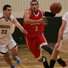 Salem's Antonio Reyes is defended by Dracut's Stephen Diamantopolous during last night's Division 2 North semi final game held at Woburn High School Photo by Deborah Parker/March 3, 2010<br /> , Salem's Antonio Reyes is defended by Dracut's Stephen Diamantopolous during last night's Division 2 North semi final game held at Woburn High School Photo by Deborah Parker/March 3, 2010
