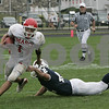 Danvers: Masconomet's Chris Splinter misses a tackle by St. John's Brendon Felder during Saturday's game held at St. John's. As of the third period St. John's was leading 22-7.<br /> Photo by Deborah Parker/Salem News Saturday, September 06, 2008