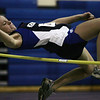 Peabody's Kelsey Incrovato competes in the high jump during last night's track meet held at Peabody Veterans Memorial High School. Photo by  Deborah Parker/December 14, 2009
