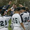 The Peabody baseball team does a cheer in between innings on Monday afternoon during their game against Salem held at Veterans Memorial High School. Photo by Deborah Parker/April 26, 2010