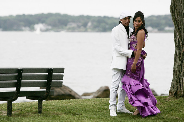 Zuleyka Gonzalez, a senior at Beverly High School and her date, Daniel Rodriguez of Beverly, pose for a picture at Lynch Park before the start of prom Thursday evening. Photo by Deborah Parker/June 11, 2009