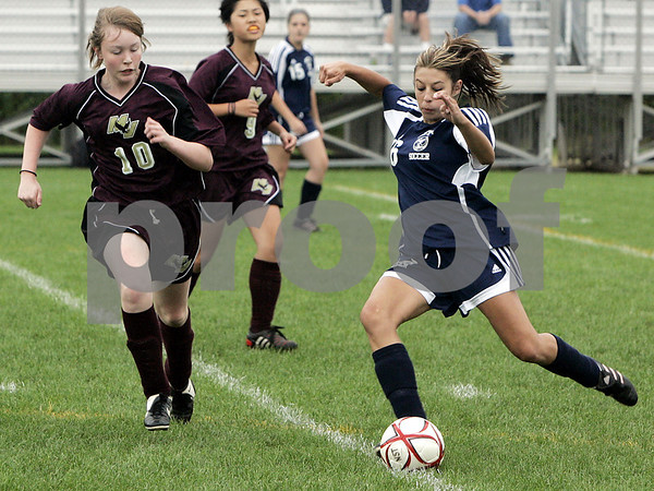 Middleton: North Shore Tech's Ashley Suzor looks to pass the ball during last night's game against Mystic Valley held at North Shore Technical School. As of the first period the Bulldogs lead 1-0. This is the first time North Shore Tech has had a girls team and second game of the season.<br /> Photo by Deborah Parker/Salem News Friday, September 12, 2008