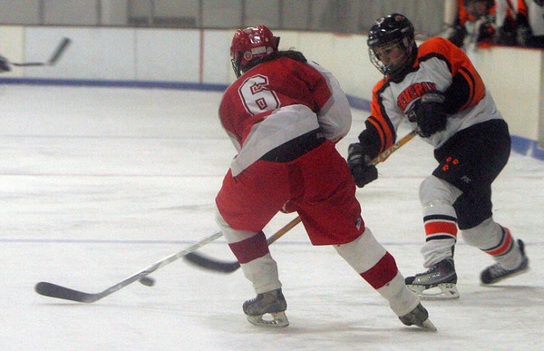 Beverly's Brittany Russo shoots on goal against Masco's Meg Twomey during last night's game held at Talbot Rink in Gloucester. photo  by Deborah Parker/January 4, 2009
