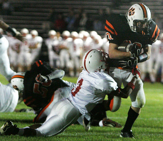 Melrose's Derek Dortch attempts to bring down Beverly's Dylan Terry near the end zone during last night's game under the lights at Hurd Stadium. Photo by Deborah Parker/September 17, 2009